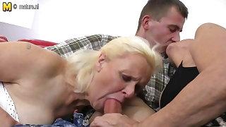 Two grandmas enjoy a big cock in threesome