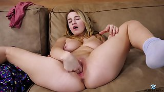 Cute tender babe upon a naturally well-aged body masturbating on the couch