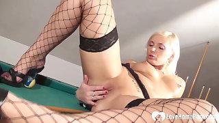 Sexy blonde in stockings masturbates on pool table